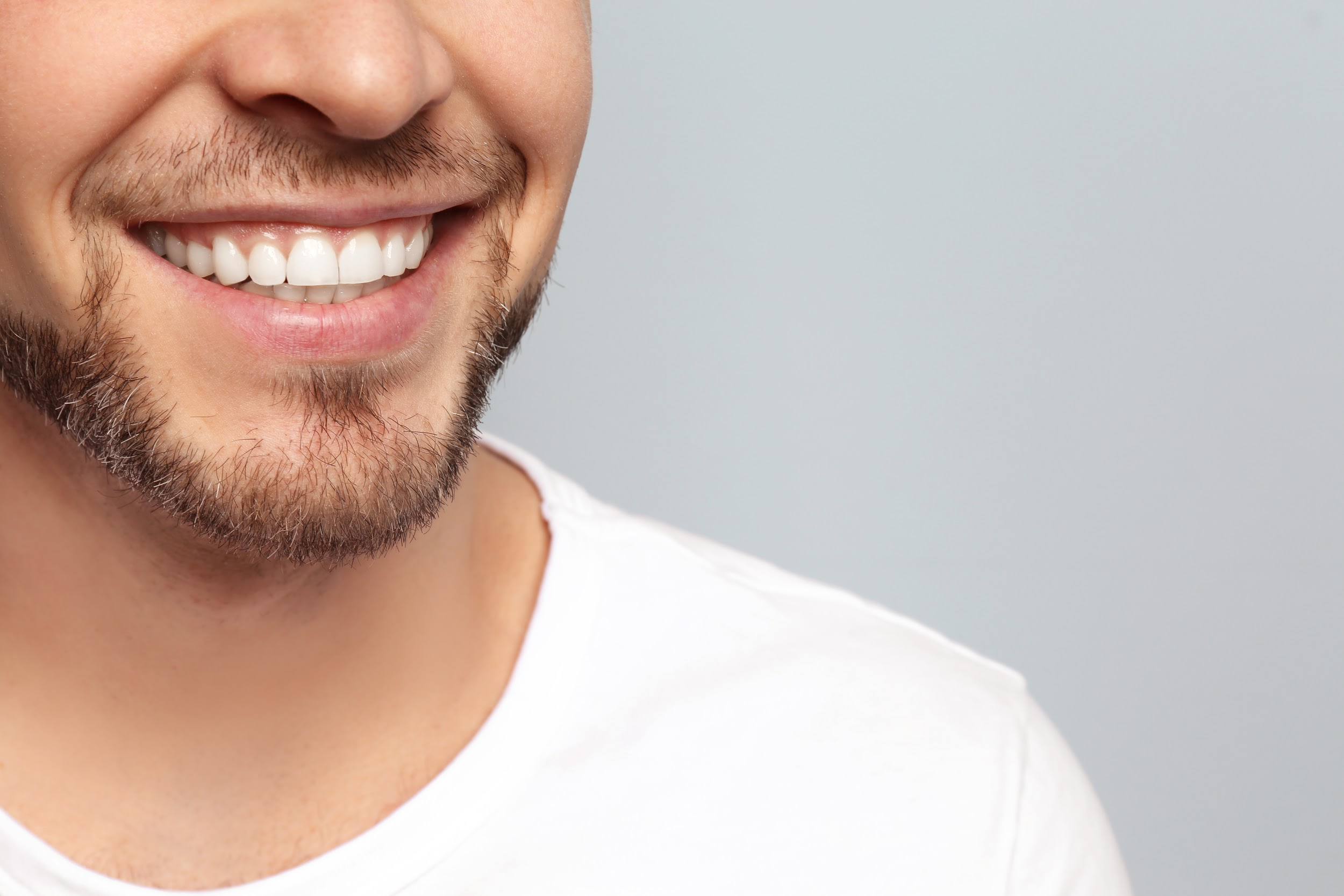 Man with straight teeth after using ClearCorrect aligners shows off his smile